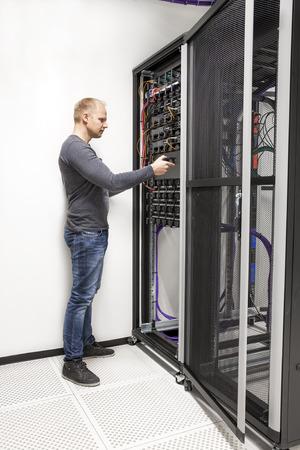 computer repairing: IT consultant build network rack in datacenter