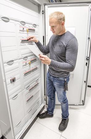 service engineer: Engineer works in power cabinet