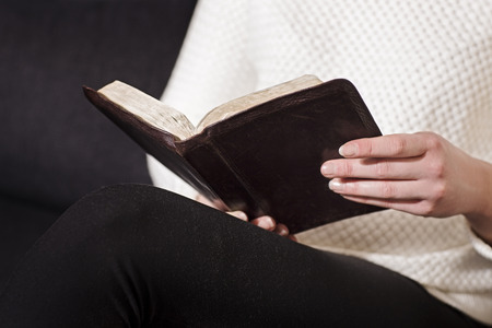 Woman sits and read the bible