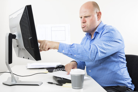 too much: Hard working businessman at the office