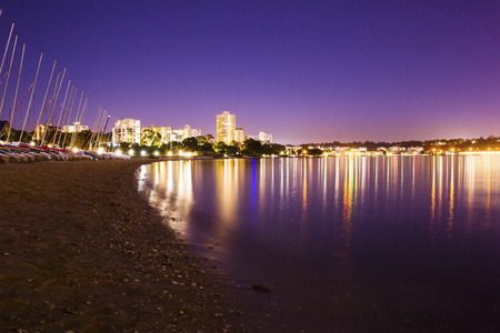 river scape: Perth city beach and boats at night