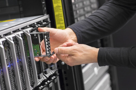 It consultant work on blade server in datacenter photo