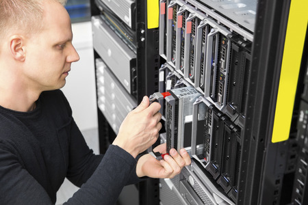 It consultant install blade server in datacenter Stock Photo