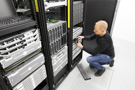 data center data centre: It engineer replace harddrive in datacenter Stock Photo