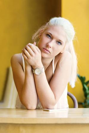 Thoughtful teenage girl with beautiful blue eyes photo