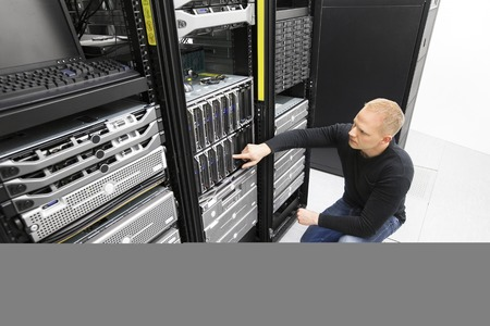 server technology: It consultant monitors servers in datacenter