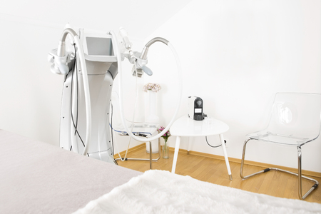 lymphatic drainage therapy: Treatment room at a professional non-surgical full body shape and skin lift clinic. Advanced technology for lipo reduction, laserporation, radiolift and microdermabrasion.