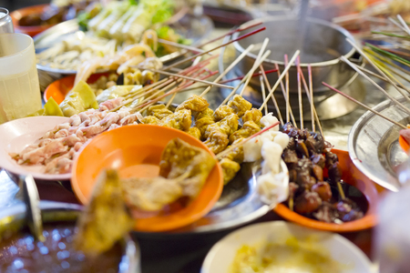 Traditional street food called lok lok. Sticks with meat, tofu, fish and vegetables ready to be boiled.