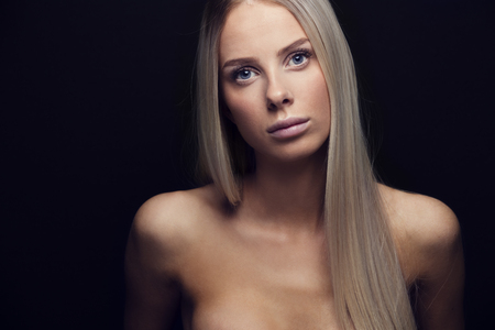 young girl nude: Beautiful young blonde woman with blonde hair. Natural and light retouched studio potrait.