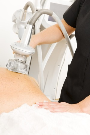 connective: Female client gets slimming and cellulite therapy with vacuum at professional beauty clinic. Use for lymphatic drainage and connective tissue massage.