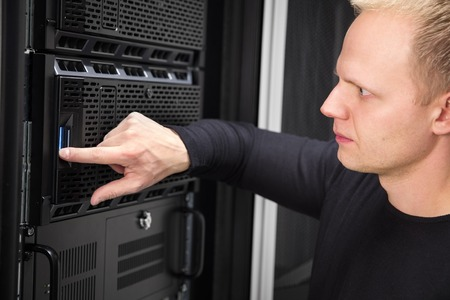 proffesional occupation: It engineer or technician work with server in data rack. Shot in large enterprise datacenter.