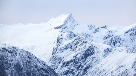 artic circle: Mountains covered with snow in the cold arctic environment. Stock Photo