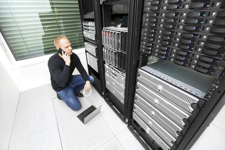 datacenter: It engineer or technician monitors and solving problems with servers and network equipments in data rack. Shot in datacenter.