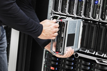 it technician: IT Technician Installing Blade Server In Chassis Stock Photo