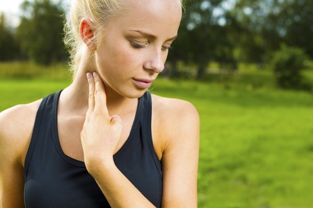 resting heart rate: Blonde woman checks her pulse after a long run