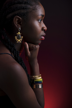 Colorful and creative side view portrait of african woman with dark skin Stock Photo