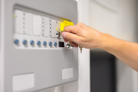 IT Engineer Using Key To Open Fire Panel In Datacenter
