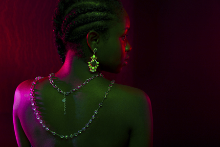 Colorful and creative portrait of african womans back with dark skin Stock Photo