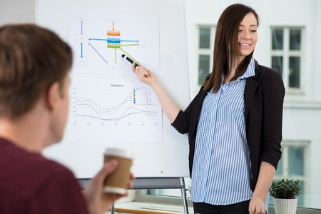 Businesswoman Looking Away While Giving Presentation