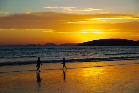 aonang: Children Walking At Beach During Sunset Stock Photo