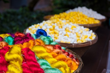 Colorful Thai Silk Threads And Cocoons In Baskets Foto de archivo