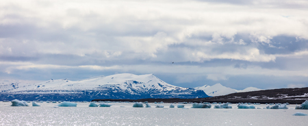 Panorama of floating sea ice in front of snowy mountains in the arctic Stock Photo