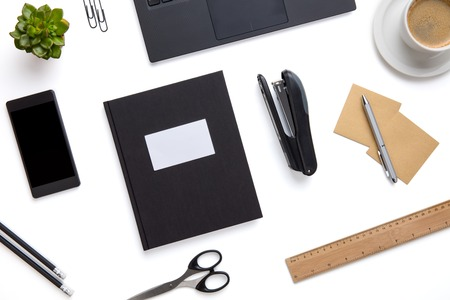 Office Supplies And Devices Arranged On Isolated White Background