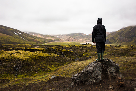 Female Hiker Standing On Rock While Enjoying Nature At Iceland