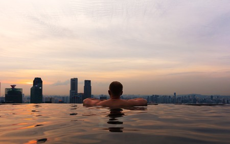 Man In Infinity Pool at Skypark Bay