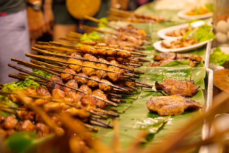 Closeup Of Chicken Satays At Market Stall Stock Photo