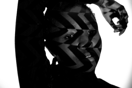 Creative pattern from projection light on beautiful woman with dark skin
