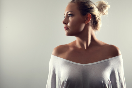 Studio portrait of gorgeous woman with blonde hair and white t-shirt Stock fotó