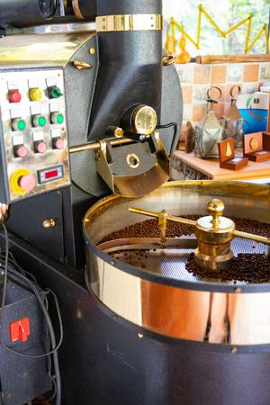 Raw Organic Coffee Beans Roasting In Machine