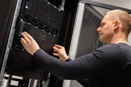 Focused Male Technician Working With Servers In Datacenter Stock fotó