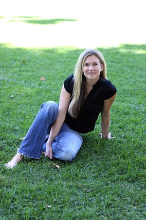 Blonde Woman sitting on the grass Stock Photo - 5756902