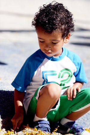 squatting down: Little Boy Squatting Down Stock Photo