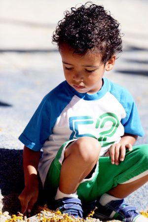 Little Boy Squatting Down Banco de Imagens