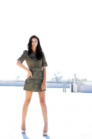 A girl standing outdoor in an empty parking structure