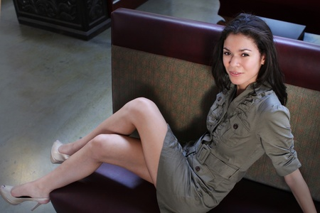 A pretty young woman relaxing indoors on a couch photo