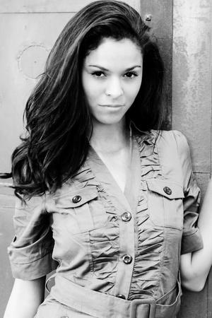 Pretty brunette with long dark hair Фото со стока