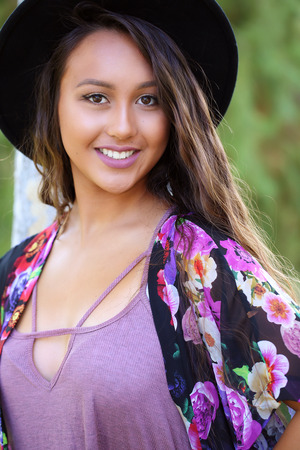 Pretty girl with a tan wearing a black hat