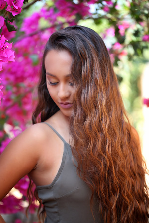 Girl with bougainvillea background