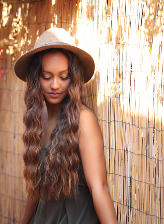 竹塀に対して長い髪の美少女 写真素材