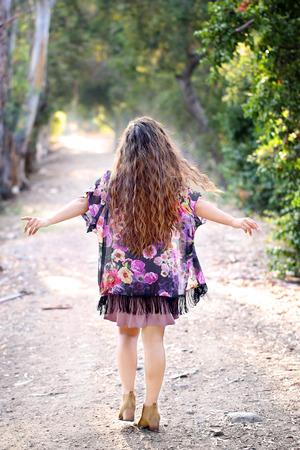 Girl walking the dirt road