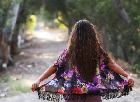 Girl walking down a path