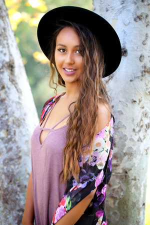 Pretty girl with long hair and a flowered kimono and hat Фото со стока