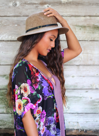 Cute long haired girl with hand on hat