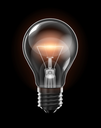 Transparent glowing bulb with a yellow filament of incandescence on a black background.