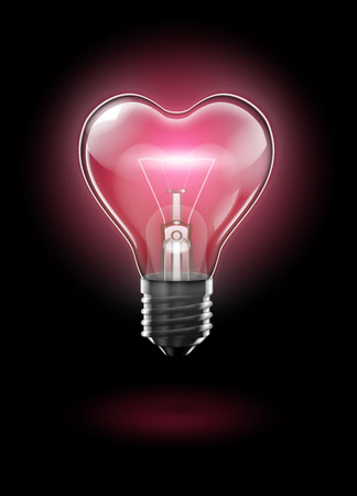 A transparent heart-shaped bulb against a dark background glows with a delicate pink light with bright tungsten filament.