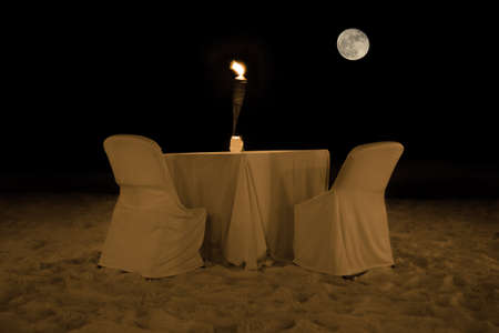 moon chair: Romantic dinner table in the evening at a beach on Aruba